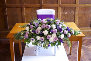 chair coverings weddings purple and white wedding flowers
