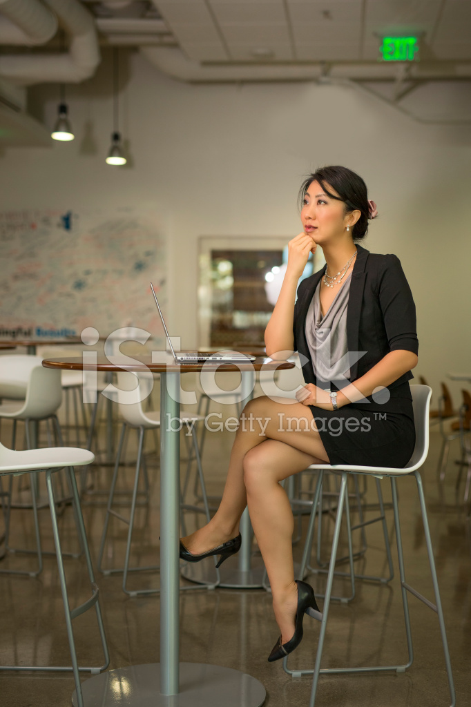 industrial office chair confident businesswoman crossing legs on high chair