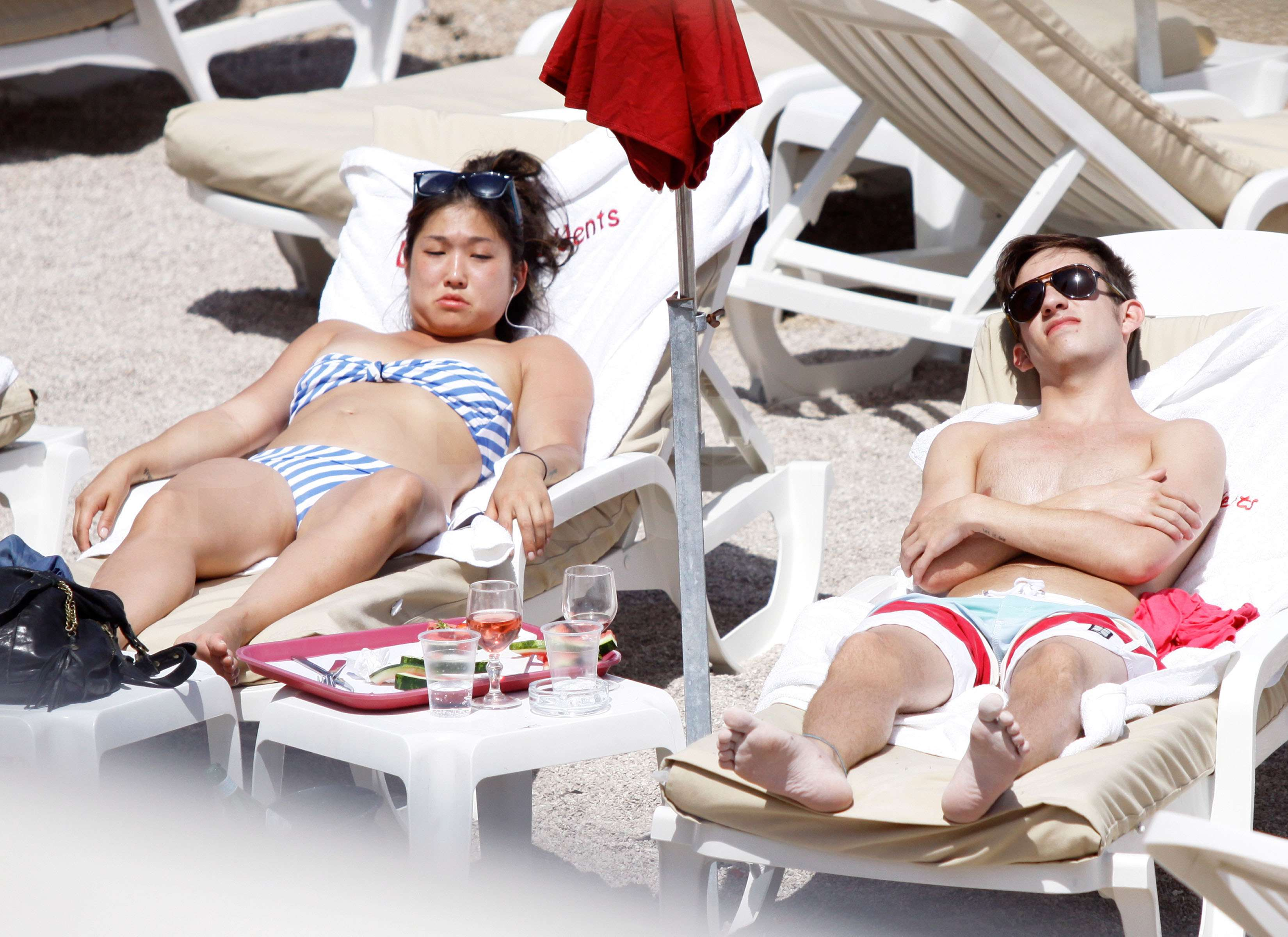 sunning lounge chair pictures glee jenna ushkowitz bikini costar kevin mchale shirtless monaco
